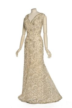 Gown, Christian Dior for the House of Dior: 1953 spring/summer haute couture collection, cotton lace figured with faux pearls, rhinestones and beads.