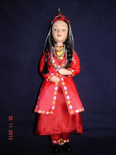 Porcelain doll in cloth national costume - Turkmenistan Republic