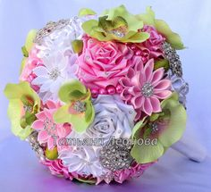 Brooch bouquet. Original handmade Wedding Bouquet in in a in pink and green color. Flowers made of satin ribbon, decorated with jewelry. Bouquet