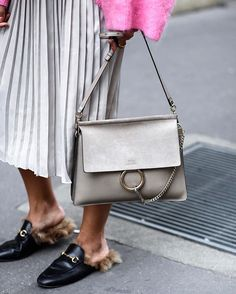 WEEKEND CHIC: Add a luxe finish to daytime with these cult accessories. Contrast a laid-back loafer and must-have 'Faye' bag with a pretty, pleated skirt. Search 799600 ( bag) and 723247 ( shoes) to shop at by Faye Bag, Chloe Bag, Dolce & Gabbana, Cute Purses, Purses And Bags, Miu Miu, Ysl, Handbag Accessories, Fashion Accessories