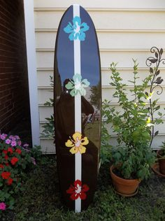 Surfboard wall hanging, four foot surfboard wall hanging, rainbow hibiscus by FLYONEBOARDSHOP on Etsy https://www.etsy.com/listing/101058859/surfboard-wall-hanging-four-foot