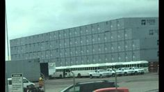 Suspicious! Convoy of White Buses Seen Entering and Leaving Port of Jacksonville, Florida and stacks of shipping containers. DAHBOO77 on Jun 29, 2015 www.undergroundworldnews.com