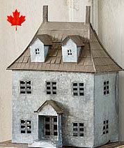 """Fairy Garden House Canada This ones called the 'French Chateau' Made of tin and measures 9""""h x 4""""w x 6""""L. As with our other tin houses..the top lifts for access to the inside. Finally available in Canada"""