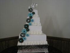 Wedding Cake.  Buttercream Frosting with Fondant/Gumpaste Turquoise, Black and Zebra Print Flowers.