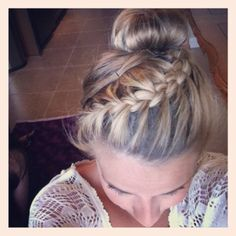 Use due sheild 07. Start in front section and French braid all the way back the the opposite section. Bull remaining hair into a bun. Spray with pureology 21 spray