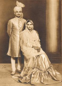 Newly weds, circa early 1940's. Lucknow, United Provinces of Agra and Oudh, India. In this picture, the groom is wearing a Sherwani, a North-Indian style turban and a Chooridar Paijama. The lovely bride is wearing a Farshi Paijama.