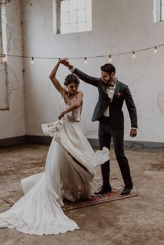 The skirt on this two-piece bridal gown is absolutely mesmerizing | Image by Kira Stein #wedding #weddinginspiration #fallwedding #industrialwedding #bohemianwedding #bohowedding #boho #industrial #bohemian #bride #bridalinspiration #weddingdress #groom #groominspiration