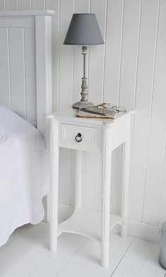 New England white beside table with silver handle A tall narrow
