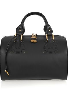 Chloé's elegantly structured black leather duffle bag is a sophisticated everyday carryall. Hold this beautifully crafted piece in the crook of your arm to lend a delicate dress a menswear-inspired finish.    CHLOÉ  Aurore leather duffle bag  $1,895