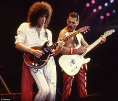 Back in the day: Brian with Queen frontman Freddie Mercury back in 1982...
