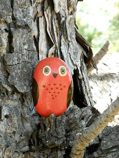 Demure orange painted rock owl (I love the idea of abandoning rock owls in trees :)