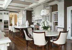 Kitchen. Kitchen with white cabinets, Honed Danby Marble countertop and hardwood floors. #Kitchen #WhiteKitchen