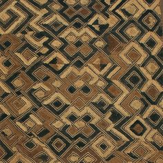 This is an example of the smaller Kuba Cloth made with an elaborate cut-pile embroidery of geometric patterns in rich earth tones. Measuring 45.5 x 22.5 inches it would look wonderful as a wall hangin