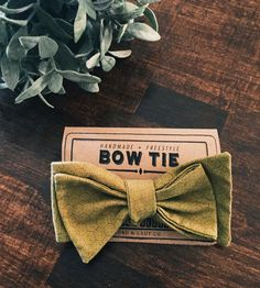 Sage-colored bow tie with a honeycomb pattern