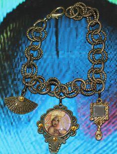 Ochun Oshun inspired modern charm bracelet by ModernOrisha on Etsy, $15.00