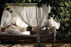 i long for an outdoor bed... where i can nap in the shade of a canopy while the breeze blows the scent of flowers and i can hear the rustle of wind in the trees...