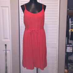 Old navy coral/ orangey lined sundress! Super cute! Lined sundress with adjustable straps. Can dress it up or down. Size large. With matching belt. Very flattering! I will bundle! Old Navy Dresses