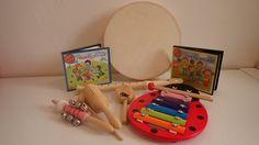 Hudobny balicek - bubon, xylofon, rolnicky, flauta, kastanet na rucke, agogo a 2 CD s detskymi pesnicka aj v karaoke verzii.