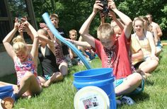 how to play water bucket relay games for kids which make such fun outside activities and summer party games. These relay races are easy to play and quick to organize. summer party games Throw the Best Summer Party Ever With These DIY Ideas Kids Will Love Kids Relay Races, Relay Games For Kids, Youth Games, Water Games For Kids, Outdoor Games For Kids, Activities For Kids, Outdoor Activities, Indoor Games, Outside Games For Kids
