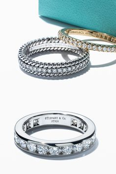 Dazzling diamond wedding bands perfectly complement a Tiffany engagement ring. From top: Tiffany Metro ring, Tiffany Schlumberger® Rope two-row ring and Tiffany® Diamond wedding band.