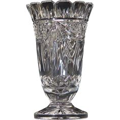 Waterford Society VaseWaterford Society Vase This limited production vase is the epitome of elegance. James O'Leary, the Design Director of Waterford Crystal designed this vase. It has absolutely beautiful details including, a scalloped edge top, diamond cuts and deep sweeping swag cuts. A beautiful blossom cut adorns the underside of the foot. Crystal Glassware, Antique Glassware, Waterford Crystal, Cut Glass, Glass Art, Crystal Illustration, Crystal Design, Stone Sculpture, Fenton Glass