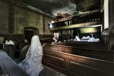 An abandoned church with a few lingering parishioners, Netherlands
