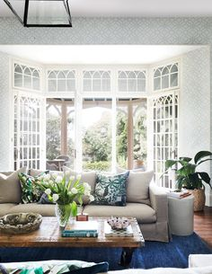 Light blue patterned wallpaper and open French doors create a sunny and inviting living room in Sydney's Historic Bronte House. Photography: Prue Ruscoe | Stylist: Kate Nixon
