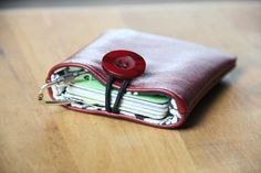 Love this—stitch a small pocket from a scrap of leather or old jeans for all those loyalty cards that save you money. Crafty Staci has the instructions.