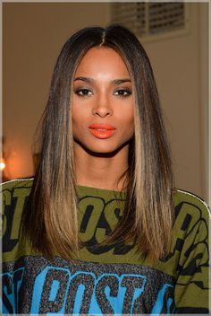 Ciara is rocking that orange lipstick!!! my fave color for the #LIP-SWAG LOL..she did that ..YOU GO GURL