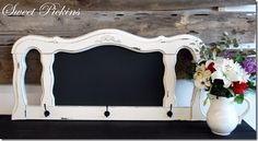 Upcycled headboard to chalkboard and coat rack. Original at http://www.sweetpickinsboutique.com/2011/12/decorative-chalkboard-whooksfor-sale.html
