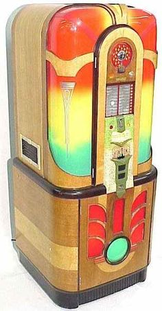 - 1942 Rock Ola Premier 1413 Jukebox - #music #jukebox #records #vinyl #audio #Rockola #vintage http://www.pinterest.com/TheHitman14/the-jukebox/
