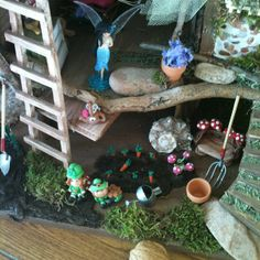 Garden in my fairy house. All veggies, flowers and leprechauns handcrafted by me using polymer clay.