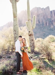 A romantic and unique warm engagement shoot in the Arizona desert, featuring orange and blue colors.  #engagementsession #loveshoot #engagementshoots #couplesession #destinationengagements