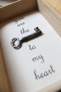 Gift idea: Frame an antique key, or even your key to your first home together. 'Key to my heart' by applecottagecrafts