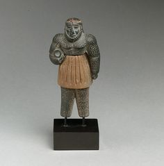 Monstrous male figure  Period:Bronze Age Date:ca. late 3rd–early 2nd millennium B.C. Geography:Bactria-Margiana or eastern Iran Culture:Bactria-Margiana Archaeological Complex Medium:Chlorite, calcite, gold, iron Dimensions:H. 4 in. (10.1 cm)