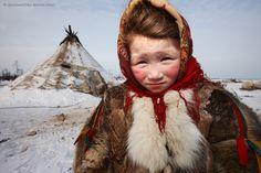 A Nenet child at her family's winter camp, Yamal Peninsula, Siberia, Russia by Alessandra Meniconzi
