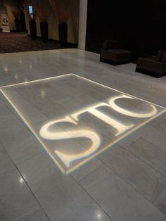 STC Logo projected on the lobby of the conference hotel.