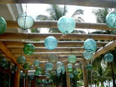 Bamboo pergola with hanging antique Japanese glass fishing floats/buoys