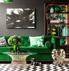 Green velvet and dark grey walls with a touch of brass=sophistication.