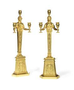 A 19th century Pair of Empire style gilt-bronze candelabra, circa 1830.