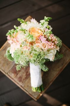 peach and green bouquet, photo by Mustard Seed Photography http://ruffledblog.com/rustic-texas-wedding #flowers #weddingbouquet