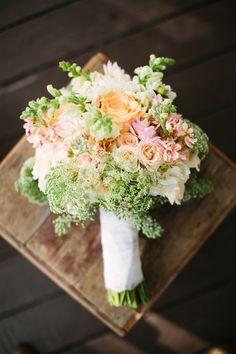 peach and green bouquet, photo by Mustard Seed Photography http://ruffledblog.com/rustic-texas-wedding #flowers #weddingbouquet