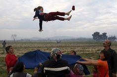 #صورة_من_الأخبار       Children play at the makeshift Idomeni camp near the border between Greece and Macedonia.