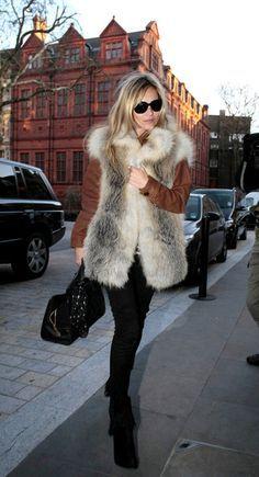 Grey fur jacket (or vest?) with brown leather sleeves, black skinny jeans, booties & handbag