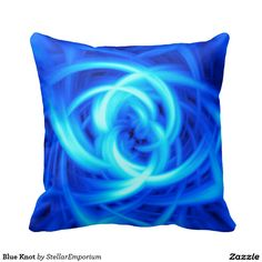 A cool abstract blue pillow with a swirling pattern.