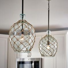 Kichler Montane Olde Bronze Coastal Tinted Glass Globe Pendant Light at Lowe's. This olde bronze finish pendant is part of the Montane collection. The clear green tinted sea glass with rope netting adds a nautical charm. Coastal Kitchen Lighting, Coastal Light Fixtures, Bathroom Pendant Lighting, Beach House Lighting, Nautical Lighting, Cottage Lighting, Coastal Chandelier, Beach House Decor, Beach Condo
