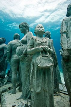 Silent Evolution sculpture installation by Jason deCaires Taylor - Cancun, Mexico