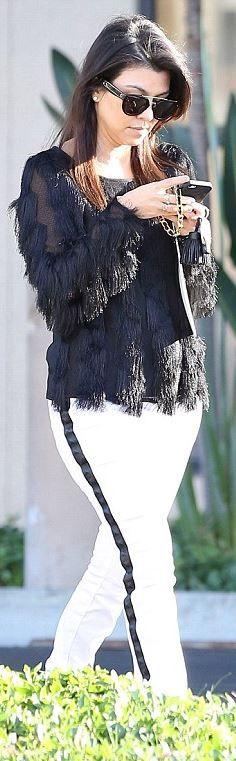 Who made  Kourtney Kardashian's black fringe shirt, white skinny jeans, and black sunglasses?
