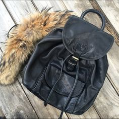 Vintage black backpack Super chic genuine leather backpack. So on trend! Fur accessory not included Vintage Bags Backpacks