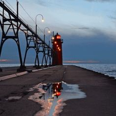 Oh what fun it is to play with #SouthHaven Lighthouse reflections! A stunning photo shared by Instagram Friend @tototoophoto! #puremichigan #lakemichigan